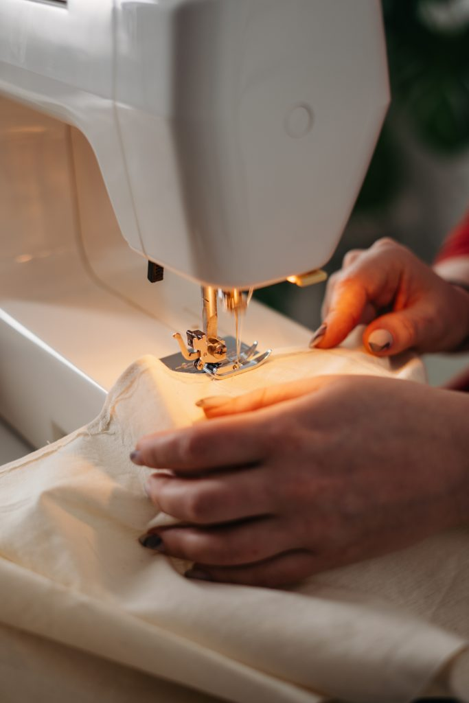 Person Using A Sewing Machine 3738095